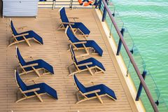 Lounge chairs on deck of cruise ship. Lounge chairs on a deck of cruise ship royalty free stock image