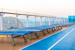 Lounge chairs on deck of cruise ship. Lounge chairs on a deck of cruise ship stock images