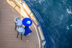 Lounge chairs on deck of cruise ship. View from a top stock photos
