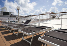 Lounge chairs on deck of cruise ship Royalty Free Stock Photos
