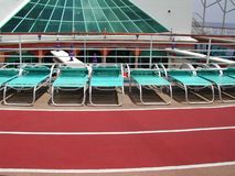 Lounge Chairs On Deck. Lounge Chairs On Deck waiting for the cruise passengers to sit on royalty free stock image