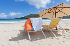 Lounge chairs at Flamenco Beach Royalty Free Stock Image