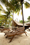 Lounge Chairs near hotel Royalty Free Stock Photography