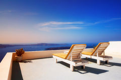 Lounge chairs overlooking the Santorini caldera, Imerovigli village Stock Images
