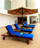 Lounge chairs poolside  Royalty Free Stock Photo