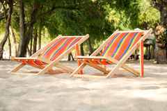 Lounge chairs for relaxing on the beach Stock Images