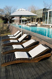 Lounge chairs and resort pool Stock Images