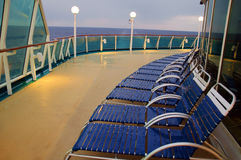 Lounge chairs in a row on a ocean cruise ship Royalty Free Stock Photography