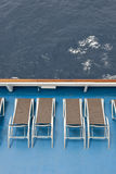 Lounge chairs on ship deck Stock Photography
