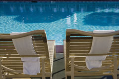 Lounge Chairs And Swimming Pool Royalty Free Stock Photos