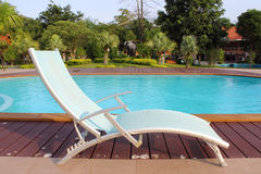 Lounge chairs. In a swimming pool invite you to relax Stock Photo