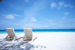 Lounge chairs tropical beach Royalty Free Stock Photo