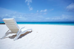 Lounge chairs tropical beach Royalty Free Stock Photography