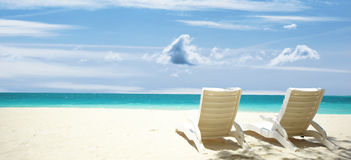 Lounge chairs tropical beach Royalty Free Stock Photos