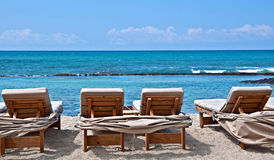 Lounge Chairs on Tropical Beach Stock Photography