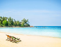 Lounge chairs on a tropical beach Royalty Free Stock Photos