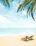 Lounge chairs on a tropical beach Stock Image