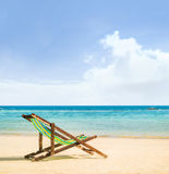 Lounge chairs on a tropical beach Stock Photos