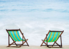 Lounge chairs on a tropical beach Royalty Free Stock Photography