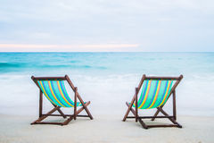 Lounge chairs on a tropical beach Royalty Free Stock Images
