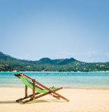 Lounge chairs on a tropical beach at summer Royalty Free Stock Photography