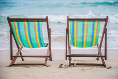 Lounge chairs on a tropical beach at summer Stock Photo