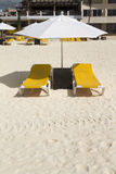 Lounge Chairs with Umbrella. A pair of beach lounge chairs with umbrella Stock Photo