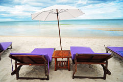 Lounge Chairs and Umbrella on the beach Royalty Free Stock Photos