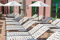 Lounge Chairs with Umbrellas Royalty Free Stock Photos