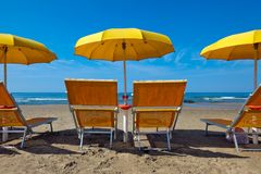 Lounge chairs under a yellow Royalty Free Stock Photos