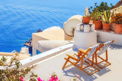 Lounge chairs with a view of the caldera, Oia village, Santorini Royalty Free Stock Photography