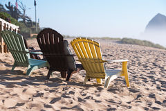Lounge chairs on the West coast of the Pacific Ocean Royalty Free Stock Photography