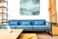 Lounge with image above and gadget in apartment Stock Photo