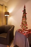 Lounge interior with chair and Xmas tree. Lounge interior with tub chair and decorated African themed Xmas tree Stock Images