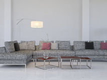 Lounge interior with gray couch and tables Stock Photography