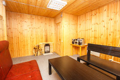 Lounge interior in wooden sauna house Stock Images