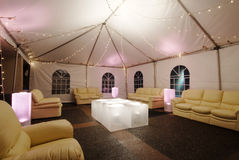 Lounge Lights. This image shows a tented lounge illuminated with little lights Royalty Free Stock Image