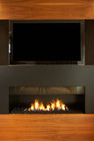 Lounge In Modern Home With TV And Fireplace Stock Images