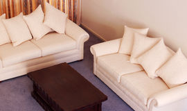 Lounge suite. Cream coloured luxurious lounge suite royalty free stock photography
