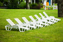 Lounge sunbed standing on green grass Royalty Free Stock Images