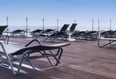 Lounge sunbeds near swimming pool Royalty Free Stock Images