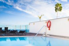 Lounge sunbeds neer  swimming pool Stock Image