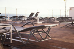 Lounge sunbeds with ocean  view, retro style Stock Images