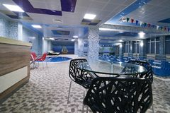 Lounge zone interior. With chairs and table in swimming pool fitness gym club Royalty Free Stock Photo