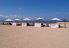Lounger by the Beach. Beach-front view seats at a luxury resort Stock Images