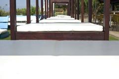 Lounger beds on beach resort Stock Photo