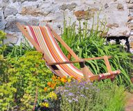 Lounger in garden Royalty Free Stock Images
