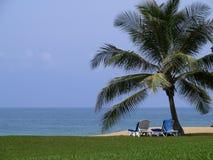 Lounger pela praia Foto de Stock