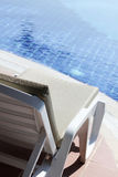Lounger by the pool. Rest and relaxation stock photo