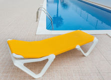 Lounger for relaxing by the pool. For tourists. Stock Photo